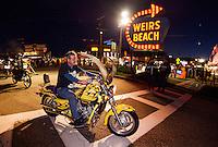Bikes head down Lakeside Avenue Friday evening during Bike Week.  (Karen Bobotas/for the Laconia Daily Sun)