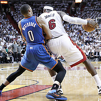 19 June 2012: Miami Heat small forward LeBron James (6) posts up Oklahoma City Thunder point guard Russell Westbrook (0) during the Miami Heat 104-98 victory over the Oklahoma City Thunder, in Game 4 of the 2012 NBA Finals, at the AmericanAirlinesArena, Miami, Florida, USA.