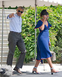 United States President Barack Obama points towards the assembled press as he and first lady Michelle Obama depart the White House in Washington, DC, USA, on Saturday, August 6, 2016 to travel to Martha's Vineyard, Massachusetts for their annual two week vacation. Photo by Ron Sachs/Pool/ABACAPRESS.COM