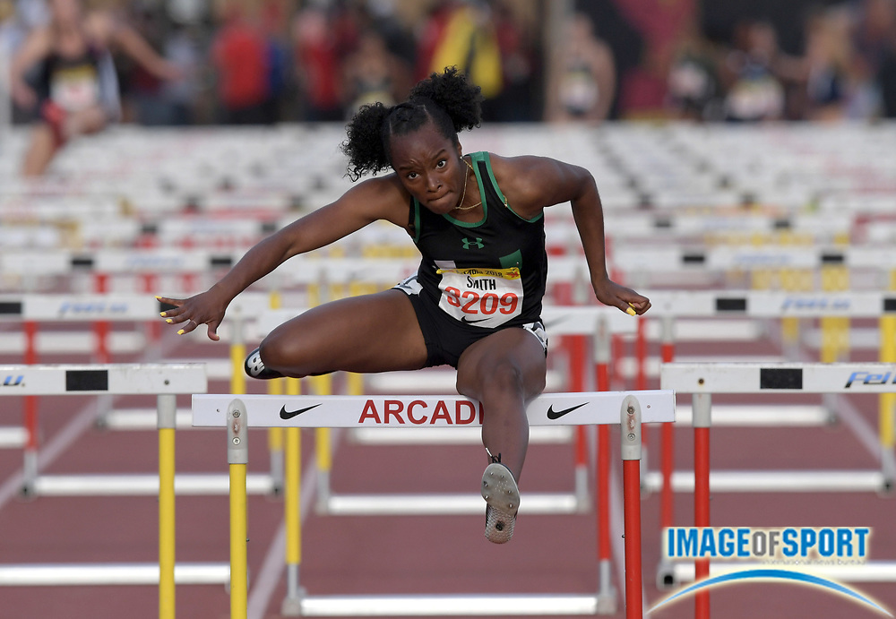 Kennedy Smith runs the anchor leg on the Upland girls shuttle hurdle relay that won the invitational race in 58.50 during the 51st Arcadia Invitational in Arcadia, Calif., Friday, April 6, 2018.