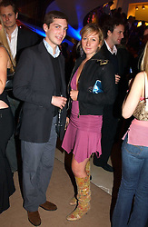WILL AITKEN and JOSIE GOODBODY at a party to celebrate the 2nd anniversary of Quintessentially magazine held at Asprey, Bond Street, London on 24th February 2005.<br />