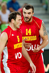 Goran Jeretin of Montenegro and Nikola Pekovic of Montenegro during friendly basketball match between National teams of Slovenia and Montenegro of Adecco Ex-Yu Cup 2011 as part of exhibition games before European Championship Lithuania 2011, on August 7, 2011, in Arena Stozice, Ljubljana, Slovenia. Slovenia defeated Crna Gora 86-79. (Photo by Vid Ponikvar / Sportida)