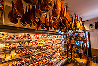 Antonio Alvarez Jamones food shop sell the dry cured hams that their company produces, that make the village of Trevelez (the highest village in Spain) famous. Mountain ham is hung to cure in a secadero  ( a cool dry place at high altitude) for 6 to 18 months. In the Alpujarra, Sierra Nevada Mountains, Granada Province, Andalusia, Spain.