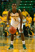 WACO, TX - JANUARY 3: Kenny Chery #1 of the Baylor Bears brings the ball up court against the Savannah State Tigers on January 3, 2014 at the Ferrell Center in Waco, Texas.  (Photo by Cooper Neill) *** Local Caption *** Kenny Chery