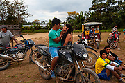 A couple and other people attend a soccer game in Boca Colorado, Peru. Boca Colorado is a town formed entirely by mining activity in the Peruvian Amazon.
