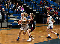 Gilford's Olivia Trindade gets pressure from Steven's Tursky/44 during NHIAA Division III opening round of tournament play Thursday evening.  (Karen Bobotas/for the Laconia Daily Sun)