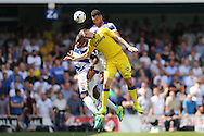 Steven Caulker of QPR and Nedum Onuoha of QPR (5) head the ball over Chris Wood of Leeds United. Skybet EFL championship match, Queens Park Rangers v Leeds United at Loftus Road Stadium in London on Sunday 7th August 2016.<br /> pic by John Patrick Fletcher, Andrew Orchard sports photography.