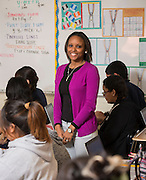 Dominique Brown works with her ninth grade math students at Austin High School, April 21, 2014.