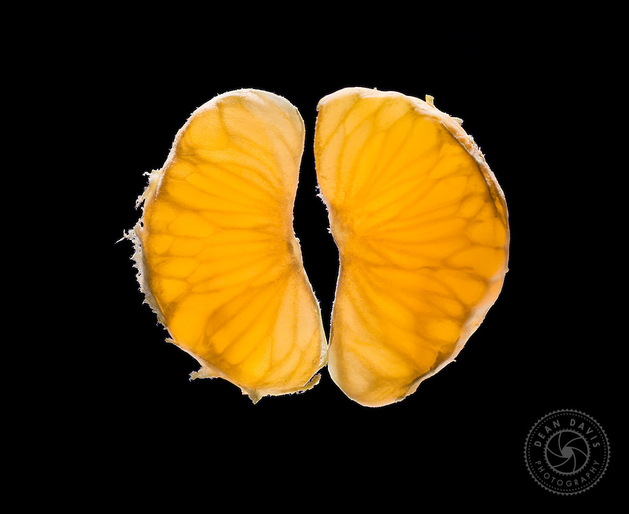 Image by Dean Davis: My mom told me not to play with my food. Did I listen? Hell no. I made this image of a clementine the day after Thanksgiving a couple of years ago. It takes the backlight very nicely and almost looks like a pair of lungs. I use it as a screensaver on my iPhone.