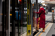 A man wearing a top hat is seen entering a tram during COVID-19 in Melbourne, Australia. Premier Daniel Andrews announced today that some minor changes will be made to the current Stage 4 Restrictions in Melbourne. As yet, there is no sign of any meaningful change despite numbers of new cases being under 5 for the 14 day rolling average. Zero cases and no deaths were recorded in the past 24 hours in Victoria. (Photo by Dave Hewison/Speed Media)