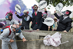 Environmental activists from Corp Rat take part in an Extinction Rebellion Stop The Harm march during the fourth day of Impossible Rebellion protests on 26th August 2021 in London, United Kingdom. Extinction Rebellion are calling on the UK government to cease all new fossil fuel investment with immediate effect.