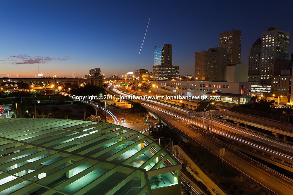 Twilight view of downtown Miami office buildings including the Miami-Dade County Courthouse, and adjacent expressway ramps to and from US Route 95. WATERMARKS WILL NOT APPEAR ON PRINTS OR LICENSED IMAGES.