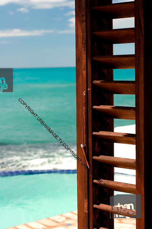 View through window to beach - Villas and cottages at Jakes Hotel - Treasure Beach Jamaica