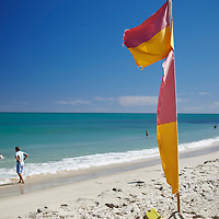 Surf lifesaving flag and swimmers at Cottesloe Main Beach