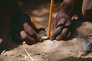 Hadza people, one of the last hunter-gatherer tribes left in Africa, Lake Eyasi region, Tanzania. Making fire with twirl stick.