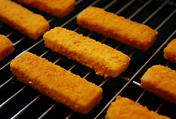 Embargoed to 0001 Friday November 02 File photo dated 11/01/07 of fish fingers under a grill. The Marine Conservation Society (MCS) found that 85\% of the fish in 48 retail own-brand and branded fingers it investigated came from sustainable sources.