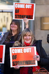 Edinburgh, Scotland, UK. 22nd October 2021. Scottish feminists stage a demonstration outside NHS Scotland offices at Waverleygate and John Lewis store in Edinburgh to protest that these organisations are paying the charity Stonewall for advice on how to create an inclusive workplace which does not differentiate between trans women and women.  Stonewall also ranks employers on the degree of diversity and inclusiveness that they provide. Scottish feminists protest that Stonewall does not protect women's rights and allows trans men to access women only spaces and be employed in women only jobs. Pic; Feminists protest outside NHS offices.   Iain Masterton/Alamy Live News.