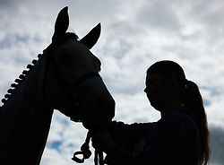 © Licensed to London News Pictures.29/08/15<br /> Bilsdale, UK. <br /> <br /> A rider adjusts the bridle on her horse during the 105th Bilsdale Country Show in North Yorkshire.<br /> <br /> Photo credit : Ian Forsyth/LNP