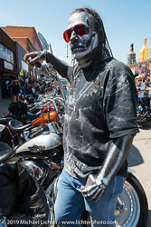 A body painted Jayde Franko on Sturgis' Main Street during the annual Black Hills Motorcycle Rally. SD, USA. August 9, 2014.  Photography ©2014 Michael Lichter.