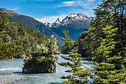 Hedin Peak 2135m rises above a tree-dotted island in the Dart River on the Rees-Dart Track. In 5 days, we tramped the strenuous Rees-Dart Track for 39 miles plus 12.5 miles side trip to spectacular Cascade Saddle, in Mount Aspiring National Park, Otago region, South Island of New Zealand.