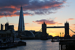 © Licensed to London News Pictures. 09/04/2014. The sun sets behind Tower Bridge and the Shard shortly before a tall ship approaches as part of the preview of this summer's tall ships regatta. Taken 8th April. Credit : Rob Powell/LNP