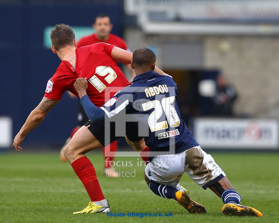 Picture by John Rainford/Focus Images Ltd +44 7506 538356.27/04/2013.Jimmy Abdou of Millwall and Simon Cox of Nottingham Forest during the npower Championship match at The Den, London.
