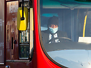 May0094715 . Daily Telegraph <br /> <br /> DT News<br /> <br /> Mask wearers in Ealing<br /> <br /> London  23 March 2020