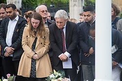 Parliament Square, Westminster, London, June 17th 2016. Following the murder of Jo Cox MP a vigil is held as friends and members of the public lay flowers, light candles and leave notes of condolence and love in Parliament Square, opposite the House of Commons. PICTURED: Speaker of the House Of Commons John Bercow reads some of the tributes.