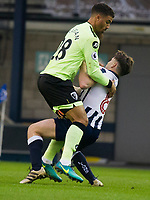 Football - 2016 / 2017 FA Cup - Third Round: Millwall vs. AFC Bournemouth<br /> <br /> Ben Thompson of Millwall &Lewis Grabban of Bournemouth collide , at The Den.<br /> <br /> COLORSPORT/WINSTON BYNORTH