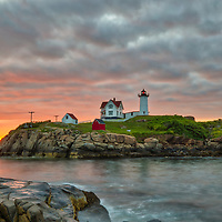 Cape Neddick Light captured at sunrise in York, ME. Loved watching this sunrise while the first light created a beautiful sky across one of Maine's most iconic lighthouses, Nubble Light. Early morning is my favorite time of the day, when I can enjoy peace and solitude.<br />