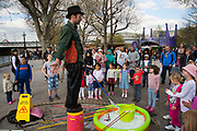 Bubble man on the Southbank riverside walkway entertains children with his performance. The South Bank is a significant arts and entertainment district, and home to an endless list of activities for Londoners, visitors and tourists alike.