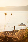 A fisherman on Aphrodite Beach in Neo Chorio, Cyprus.