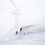 Jackson Hole Mountain Resort employees dig out the tram line after a huge snow season with a ton of southery wind loading.