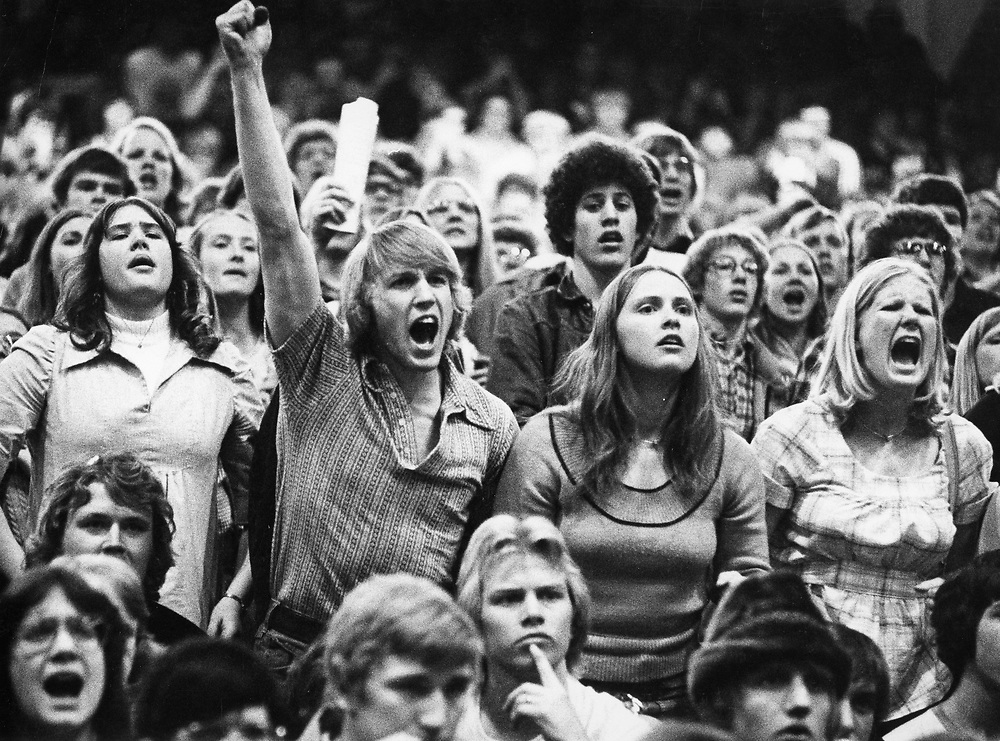 ©1973 Wrestling fans at Madison, Wisconsin state meet.