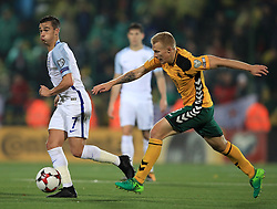 England's Harry Winks (left) and Lithuania's Ovidijus Verbickas battle for the ball during the 2018 FIFA World Cup Qualifying Group F match at the LFF Stadium, Vilnius.