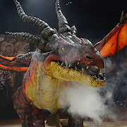 """WILKES BARRE, PA - JUNE 26:  Monstrous dragon """"Nightmare"""" breathes fire at DreamWorks' """"How To Train Your Dragon Live Spectacular"""" North American tour at Mohegan Sun at Pocono Downs on June 26, 2012 in Wilkes Barre, Pennsylvania.  (Photo by Lisa Lake/Getty Images)"""