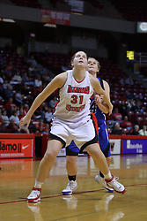 01 January 2009: Nicolle Lewis boxes out Kristina Voss. The game between the Creighton Bluejays and the Illinois State Redbirds ended with the Redbirds on top by a score of 63-43 on Doug Collins Court inside Redbird Arena on the campus of Illinois State University, Normal IL.