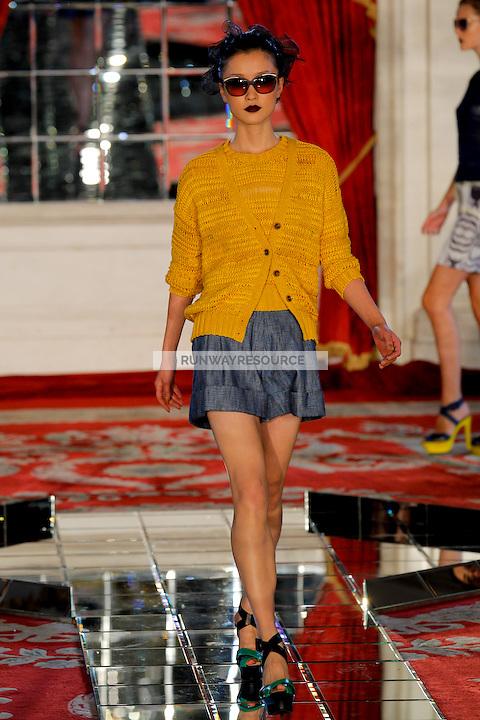 Du Juan walks the runway wearing Jason Wu Spring 2010 collection during New York Mercedes-Benz fashion week on September 11, 2009.