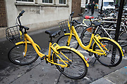 Ofo bikes ready for hire in London, England, United Kingdom. Ofo is a Beijing-based bicycle sharing company founded in 2014. It operates over 10 million yellow-colored bicycles in 250 cities and 20 countries, as of 2017. The dockless ofo system uses a smartphone app to unlock bicycles, charging an hourly rate for use.