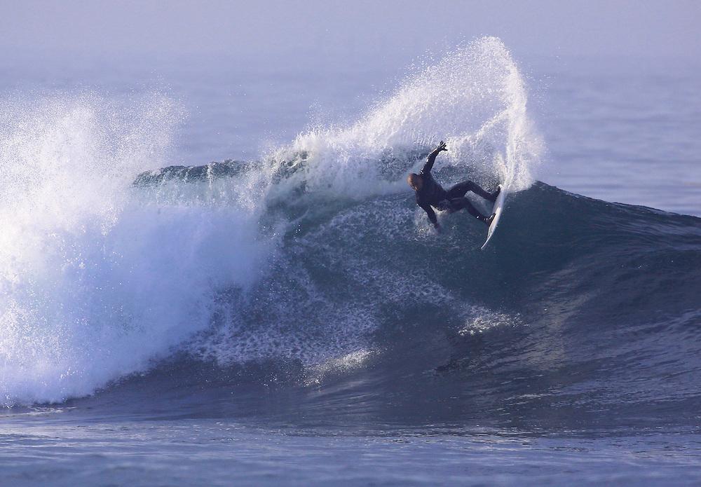 Bobby Martinez from Santa Barbara  catches waves along the central coast Wednesday, January 5, 2011.
