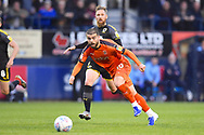 Luton Town player Elliot Lee passes the ball into the box in the first half during the EFL Sky Bet League 1 match between Luton Town and AFC Wimbledon at Kenilworth Road, Luton, England on 23 April 2019.