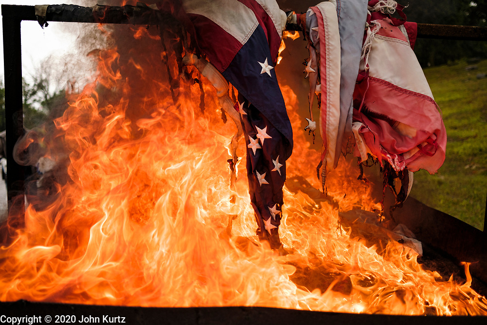 12 SEPTEMBER 2020 - DES MOINES, IOWA: US flags burn in a flag retirement ceremony at Glendale Cemetery in Des Moines. About 10 volunteers came to the cemetery Saturday morning to properly dispose of about 4,000 American flags. The flags had flown over veterans' graves, local businesses, and state offices. The US Flag Code calls for used American flags to be respectfully disposed of in a fire.    PHOTO BY JACK KURTZ