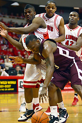 18 January 2009: Osiris Eldridge, Kellen Thornton, and Dinma Odiakosa team up to pin Chris Cooks tightly under the hoop. The Illinois State University Redbirds top the Missouri State Bears 68-56 on Doug Collins Court inside Redbird Arena on the campus of Illinois State University in Normal Illinois