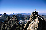 Climber Hans Florine on the summit tower of Middle Palisade peak (14, 012 ft), on the High Sierra crest in Sequoia Kings Canyon National Park.