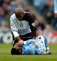 Photo. Jed Wee. Digitalsport<br /> Manchester City v Fulham, FA Barclaycard Premiership, City of Manchester Stadium, Manchester. 27/03/2004.<br /> Fulham's Luis Boa Morte checks on the condition of Manchester City's Shaun Wright-Phillips after his foul injures the City player.