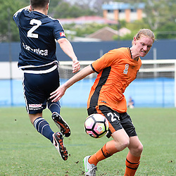 BRISBANE, AUSTRALIA - NOVEMBER 12: Kye Rowles of the Roar and Jonathan Vakirtzis of the Victory compete for the ball during the round 1 Foxtel National Youth League match between the Brisbane Roar and Melbourne Victory at Spencer Park on November 12, 2016 in Brisbane, Australia. (Photo by Patrick Kearney/Brisbane Roar)