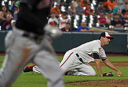 June 19, 2017 - Baltimore, MD, USA - Baltimore Orioles pitcher Richard Bleier, right, cannot make a play on an infield single by Cleveland Indians' Lonnie Chisenhall, left, in the ninth inning on Monday, June 19, 2017 at Oriole Park at Camden Yards in Baltimore, Md. The Indians defeated the Orioles by a score of 12-0. (Credit Image: © Kenneth K. Lam/TNS via ZUMA Wire)