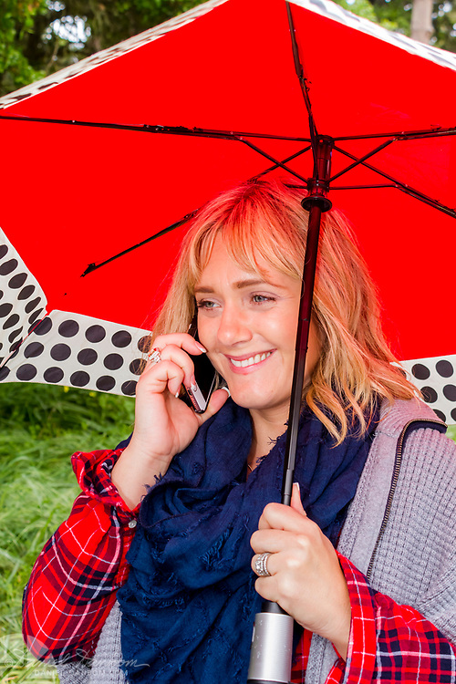 Young woman on phone under a Red Umbrella