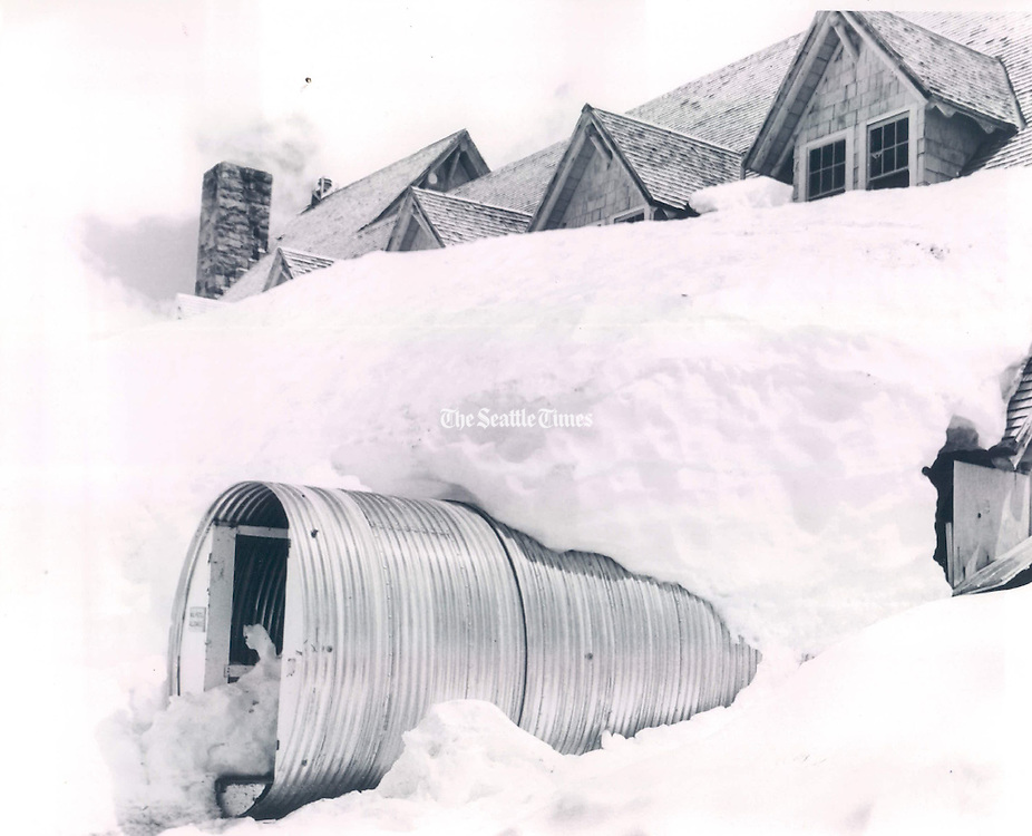 A culvert through the snow provides access to Paradise Lodge, where workers prepared the Mount Rainier National Park landmark for its scheduled opening June 19, 1971. <br /> <br /> George Carkonen / The Seattle Times