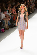 Lace dress and vest with epaulets. By Custo Barcelona at the Spring 2013 Fashion Week show in New York.